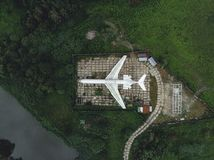 The old plane in green field by drone stock image