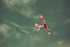 Old plane in sky Royalty Free Stock Image