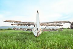 The old plane stands on the field. With broken wings Stock Photography