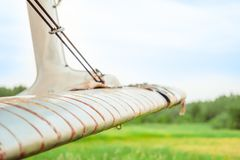 The old plane stands on the field. With broken wings Royalty Free Stock Image
