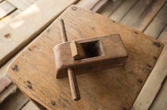 Old plane for wood working. A small asian old plane for wood working placed on a wooden chair in a workshop room Stock Photography