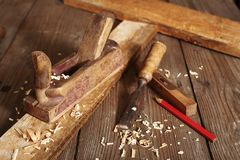 Old planer and chisel. In a carpentry workshop Stock Photography