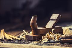Old planer and other vintage carpenter tools in a carpentry workshop.  royalty free stock photography