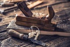 Old planer and other vintage carpenter tools in a carpentry workshop.  stock images