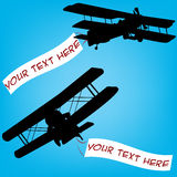 Old planes with banners Royalty Free Stock Photo