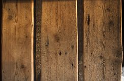 Old plank wood door. Grungy and worn old planks that make a beautiful door Stock Images