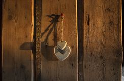 Old plank wood door. Hearts hanging on the door made of old planks Royalty Free Stock Photography