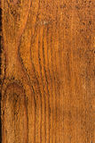Old plank of wood. A plank of wood that because of the time has a reddish color Royalty Free Stock Image