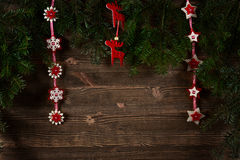 Old planks adorned with Christmas tree Stock Photos
