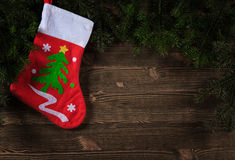 Old planks adorned with Christmas tree twigs Stock Photo