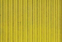 Old planks of wood painted bright yellow. stock photo