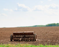 Old planter in the field Stock Photos