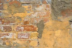 Old plaster on brick wall Stock Images