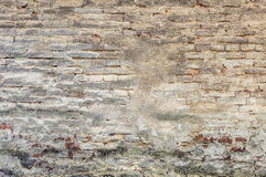 Old plaster on brick wall. Grunge brick wall of the old house. Textured background. Remains of old plaster Royalty Free Stock Images