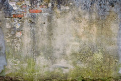 Old plaster on brick wall. Grunge textured background. brick wall of the old house. remains of old plaster Stock Photo