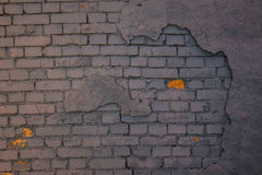 The old plaster on gray brick wall Royalty Free Stock Image