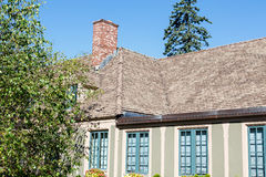Old Plaster Home and Shingled Roof Stock Image