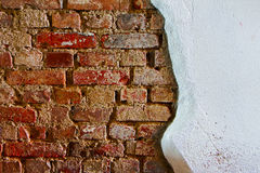 Old plaster on a red brick wall Royalty Free Stock Images