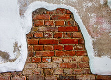 Old plaster on red brick wall Stock Photos