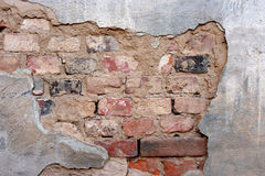 Old plaster texture wall. Plaster background with brick wall framing Stock Photo
