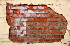 Old plaster texture wall. Plaster background with brick wall framing Royalty Free Stock Images