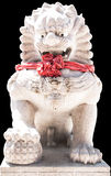 Old plaster walls in the Arts of China has carved lotus.Carved stone lions standing in a Chinese temple. Carved stone lions standing in a Chinese temple Stock Photos
