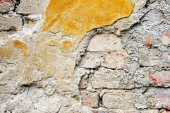Old plastered brick wall. Fragment of tumbledown plastered brick wall Stock Photography
