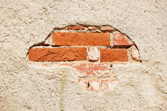 Old plastered brick wall. Fragment of tumbledown plastered brick wall Royalty Free Stock Photos