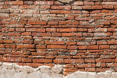 Old plastered brick wall background texture stock photos