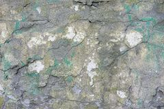 Old plastered brick wall with cracks and traces of paint. royalty free stock photos