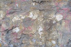Old plastered brick wall with cracks and traces of paint. royalty free stock image