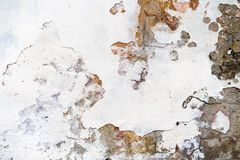 Old plastered brick wall with damaged plaster. royalty free stock photo