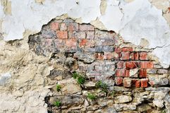 Old plastered brick wall. Fragment of tumbledown plastered brick wall Stock Images