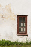 The old plastered cracked wall with a window Stock Photography