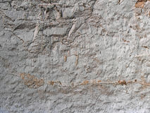 Old plastered stone wall background, plaster texture Royalty Free Stock Images