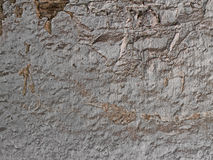 Old plastered stone wall background, rural mediterranean plaster Royalty Free Stock Images