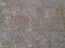 Old plastered stone wall background, rural mediterranean stone b Royalty Free Stock Image