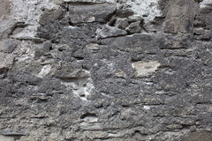 Old plastered stonewall, dark grey. Stock Images