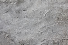 Old plastered on the whitewashed wall. Royalty Free Stock Photography