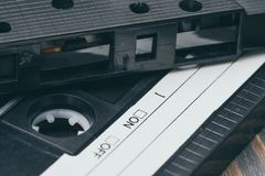 Old fashioned plastic audio cassette. Music of the 90s. Old plastic audio cassette and audio tape. Recording music in the studio in the 90`s stock photography