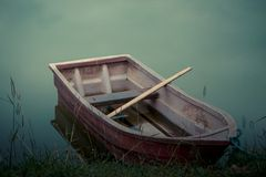 Old plastic boat. Old plastic boat in scary environment Stock Image
