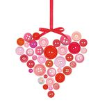 Old plastic buttons in a heart shape isolated on white Stock Image