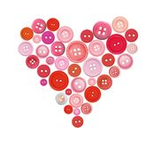Old plastic buttons in a heart shape isolated on white Stock Photos