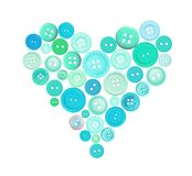 Old plastic buttons in a heart shape isolated on white Royalty Free Stock Photography