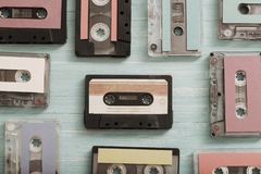 Old plastic cassette on wooden background. Retro music concept royalty free stock image
