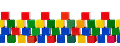Old plastic color blocks - toys isolated on white background Royalty Free Stock Image