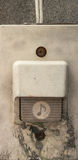 Old plastic door bell. On the grunge wall of old house Stock Image
