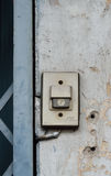 Old plastic door bell on the grunge wall Royalty Free Stock Photography