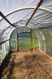 Old plastic grenhouse  hothouse in farm Stock Image