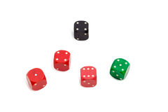 Old plastic multi colored six-sided dice with rounded corners. Old standard plastic multi colored six-sided dice with rounded corners on a light background Stock Photo